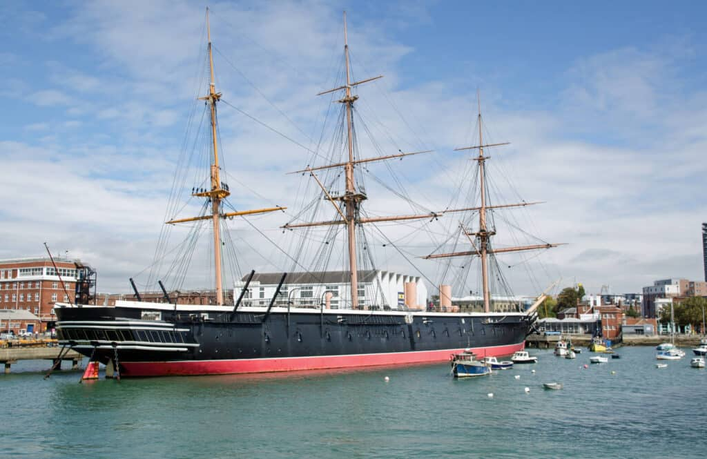 The historic HMS Warrior - Britain's first iron hulled battleship - viewed from the sea in Portsmouth Harbour, Hampshire