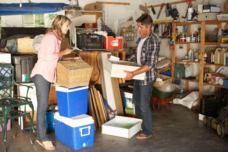 A couple are tidying the garage for moving house