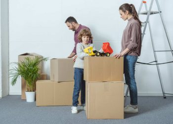 A family is getting the moving boxes ready for moving