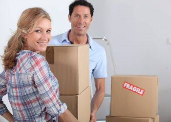 A woman and a man are moving boxes ready for removals